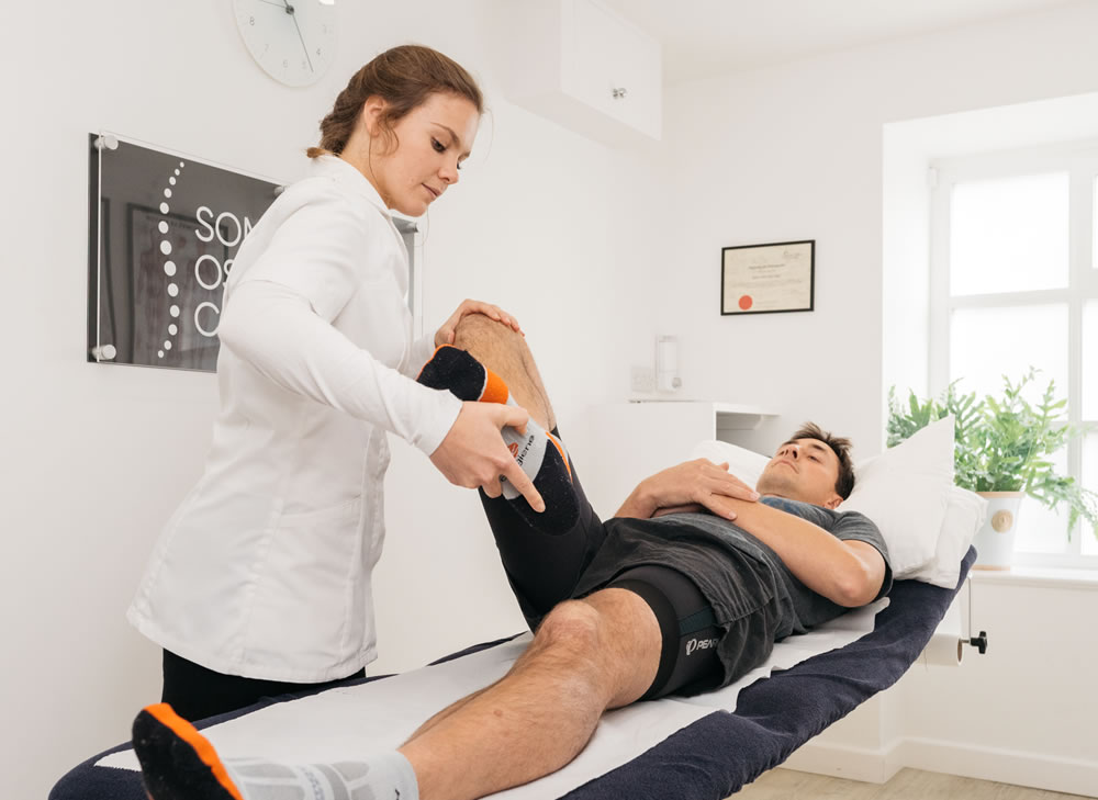 an osteopath treating a man with a sore knee